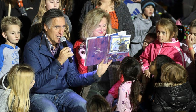 U.S. Senate hopeful Mitt Romney and his wife, Ann, read a children's book during scary tales and s'mores bonfire at Cornbelly's Corn Maze & Pumpkin Fest at Thanksgiving Point in Lehi, Utah, on Nov. 2, 2018. Romney is stumping for fellow Republican candidates as he sails toward a likely victory on Election Day.