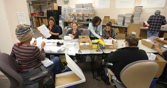 Election workers process returned voted ballots in the Salt Lake County Government Center, in Salt Lake City on Oct. 31, 2018.