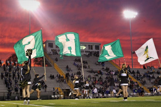 Lincoln's cheerleaders lead their football team onto the field. Godby defeated Lincoln 34-24 at Gene Cox Stadium on Friday, Nov. 2, 2018.