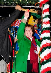 Dr. Nancy Van Vessem, one of the victims of the Hot Yoga slayings in Tallahassee Friday night. She is assisting Mayor John Marks flip on the holiday lights at Tallahassee's Festival of Lights in 2009.