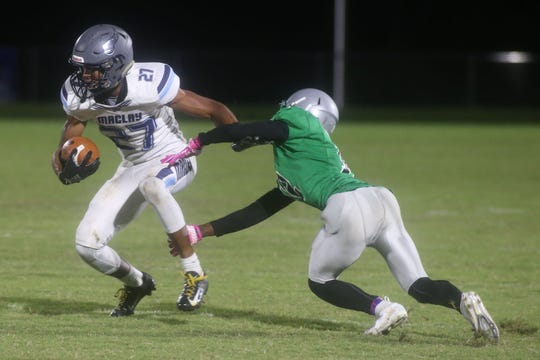 Maclay receiver Robert Parker-Crawford makes a Pataula Charter defender miss during Friday's game.