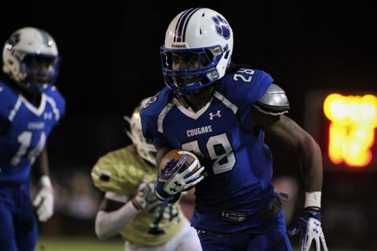 Godby running back Tyrique Paramore heads down the sideline as Godby defeated Lincoln 34-24 at Gene Cox Stadium on Friday, Nov. 2, 2018.