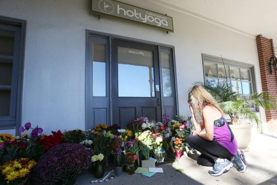 Victoria Heller, pays her respects to the victims of the shooting at Hot Yoga Tallahassee, the day after the tragedy, Nov. 3, 2018.