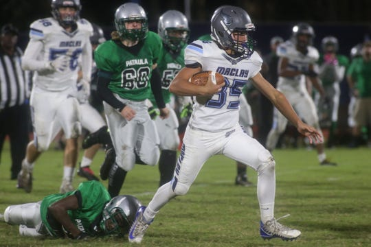 Maclay's Davidson Oberste runs for a gain against Pataula Charter.