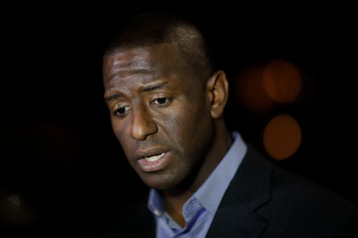 Mayor Andrew Gillum addresses reporters on the scene as the Tallahassee Police Department is investigating a shooting at Hot Yoga in Betton Place on the corner of East Bradford and Thomasville roads in Tallahassee, Fla., Friday, Nov. 2, 2018.