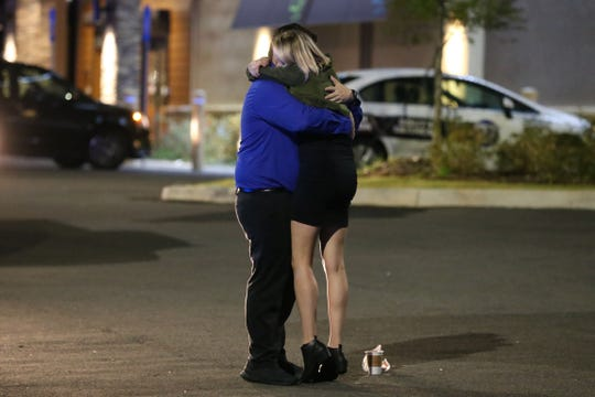 Melissa Hutchinson was working near by at in the same plaza where the shooting at Hot yoga at the intersecion of Thomasville Rd. and Bradford Rd. took place Friday, Nov. 2, 2018. Hutchinson is seen hugging friends after being so close to the action that had occurred just hours earlier.