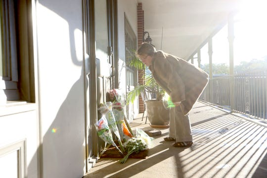 The morning after the shooting took place at Hot Yoga Tallahassee, community members leave flowers in honor of the victims on Saturday, Nov. 3, 2018.