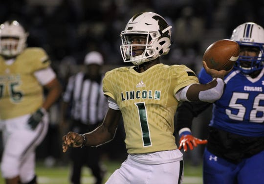 Lincoln quarterback Chris Beard throws a pass as he rolls out, but Godby defeated Lincoln 34-24 at Gene Cox Stadium on Friday, Nov. 2, 2018.