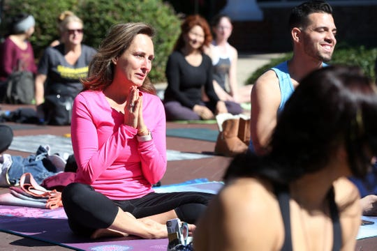 Yoga for a Cause, originally organized to help Hurricane Michael victims, becomes a community event to also create a sense of peace the day after the shooting that took place at Hot Yoga Tallahassee on Adams St. on Saturday, Nov. 3, 2018.