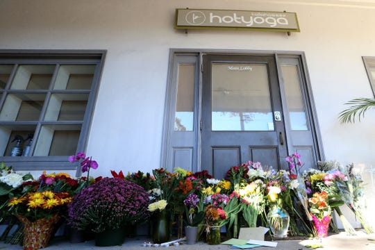 Many Tallahassee community members leave flowers, cards, and light candles in honor of the victims of the shooting that occurred at the Hot Yoga Tallahassee studio at the intersection of Bradford Rd. And Thomasville Rd. the day following the tragedy, Nov. 3, 2018.
