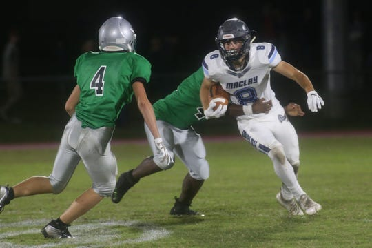 Maclay running back Ian Widener tries to gain tough yards during a win over Pataula Charter on Friday.