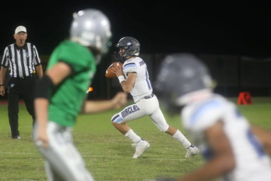 Maclay quarterback Brecht Heuchan drops back to throw a pass during a 63-6 win over Pataula Charter on Friday.
