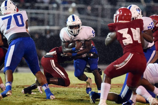 Sebastian River senior Javian Tomlinson runs the ball against Vero Beach in the 2018 regular season finale. The rivals play in the Kickoff Classic on Friday.