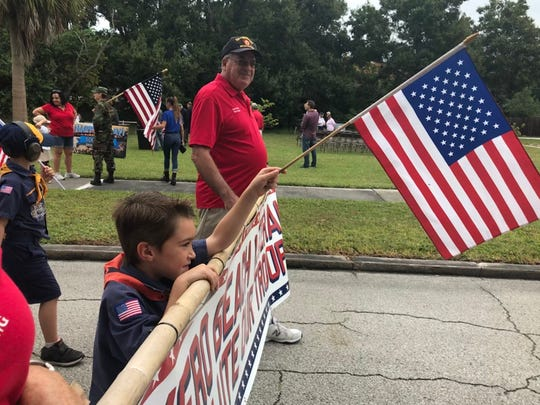 Andrew Moyer, 6, of Vero Beach, joined his family in Vero Beach's first Veterans Parade Nov. 3, 2018. The route wound from Pocahontas Park half a mile through downtown, ending with a ceremony recognizing 100 years of military service. The celebration was presented by the Vero Beach Centennial Committee and Indian River County Cultural Council. Veterans Day is Nov. 11, 2018.