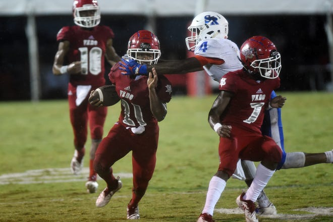 The Vero Beach High School Fighting Indians hosted county rival Sebastian River Friday, Nov. 2, 2018 in a rain-soaked game at the Citrus Bowl. The Fighting Indians won 21-0 completing their fifth consecutive undefeated regular season.