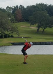 Port St. Lucie's Fletcher Wunderlich hits an 8-iron on the eighth hole of the Class 2A state tournament at Mission Inn Resort at Howey-in-the-Hills.