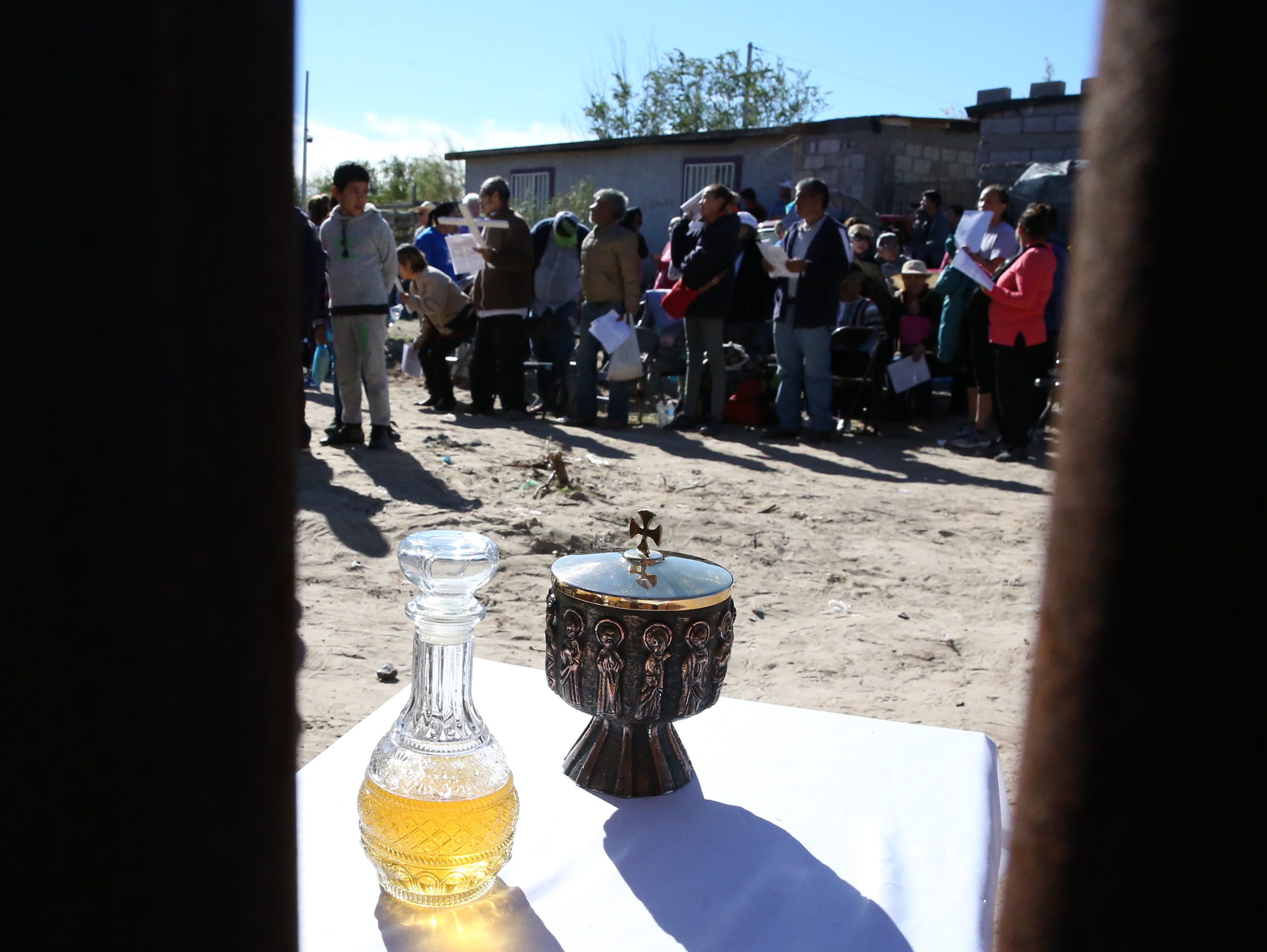 Communion at the border fence Saturday.