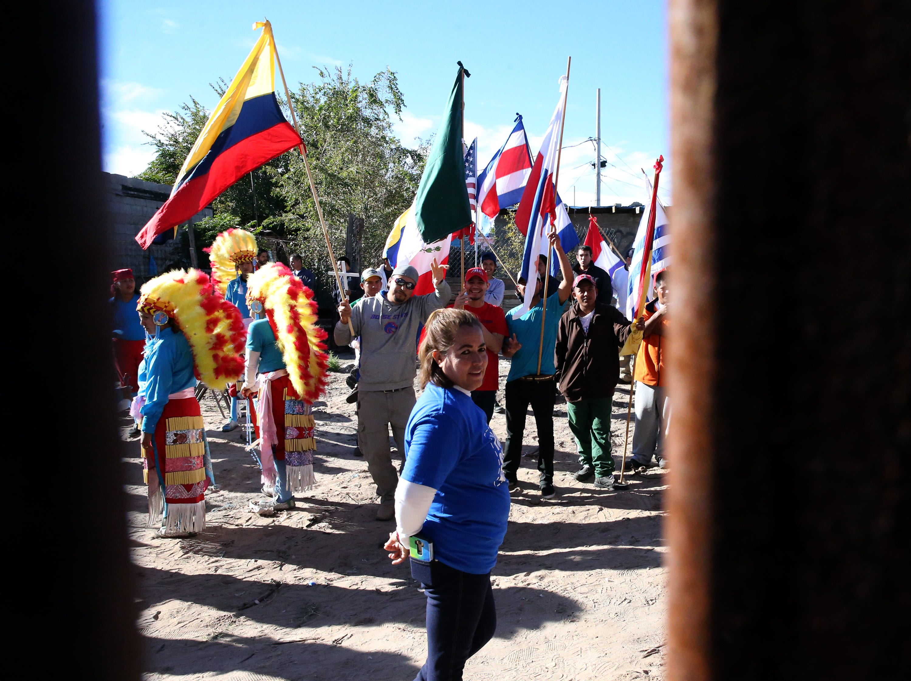 The gathering of flags on the Mexican side of the border fence Saturday.