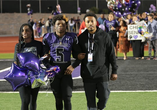 Franklin High School football player James McClain-Green, center, was honored during senior night earlier this season when the Cougars played Pebble Hills.
