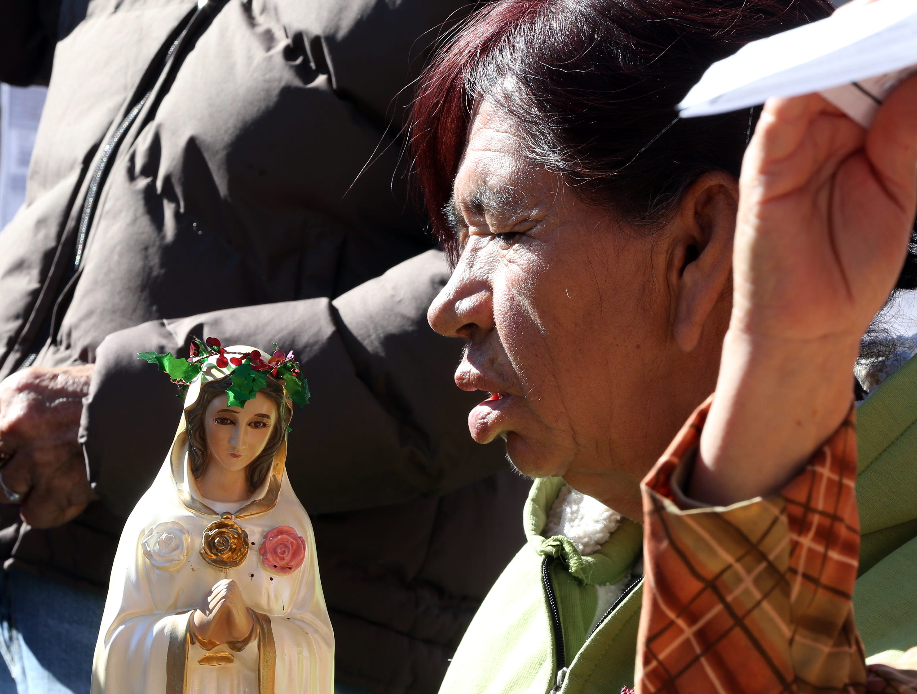 A Mexican woman takes part in the annual Border Mass in the Juarez area of Anapra Saturday.