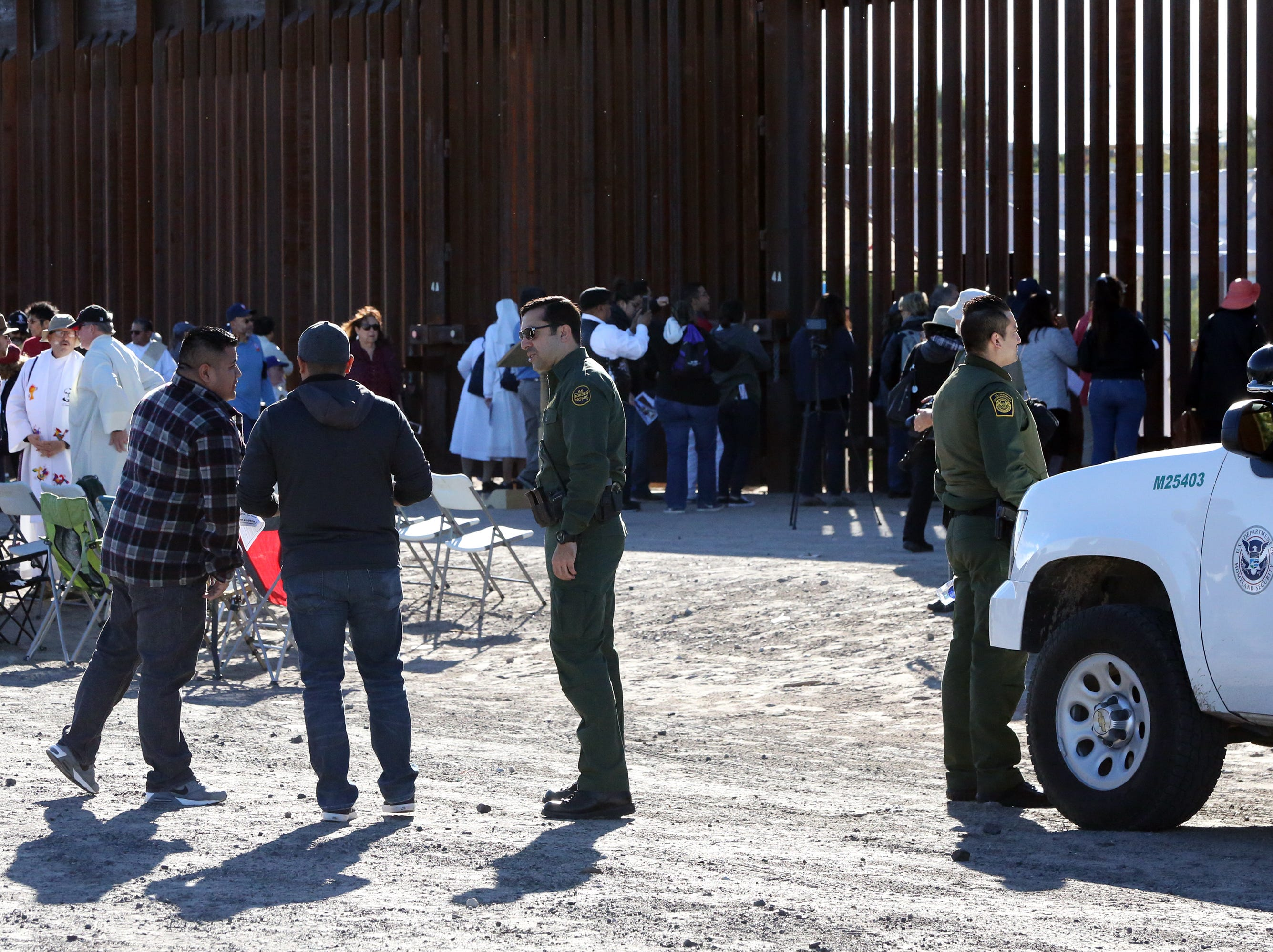 U.S. Border Patrol agents talk with some of the Border Mass participants Saturday.