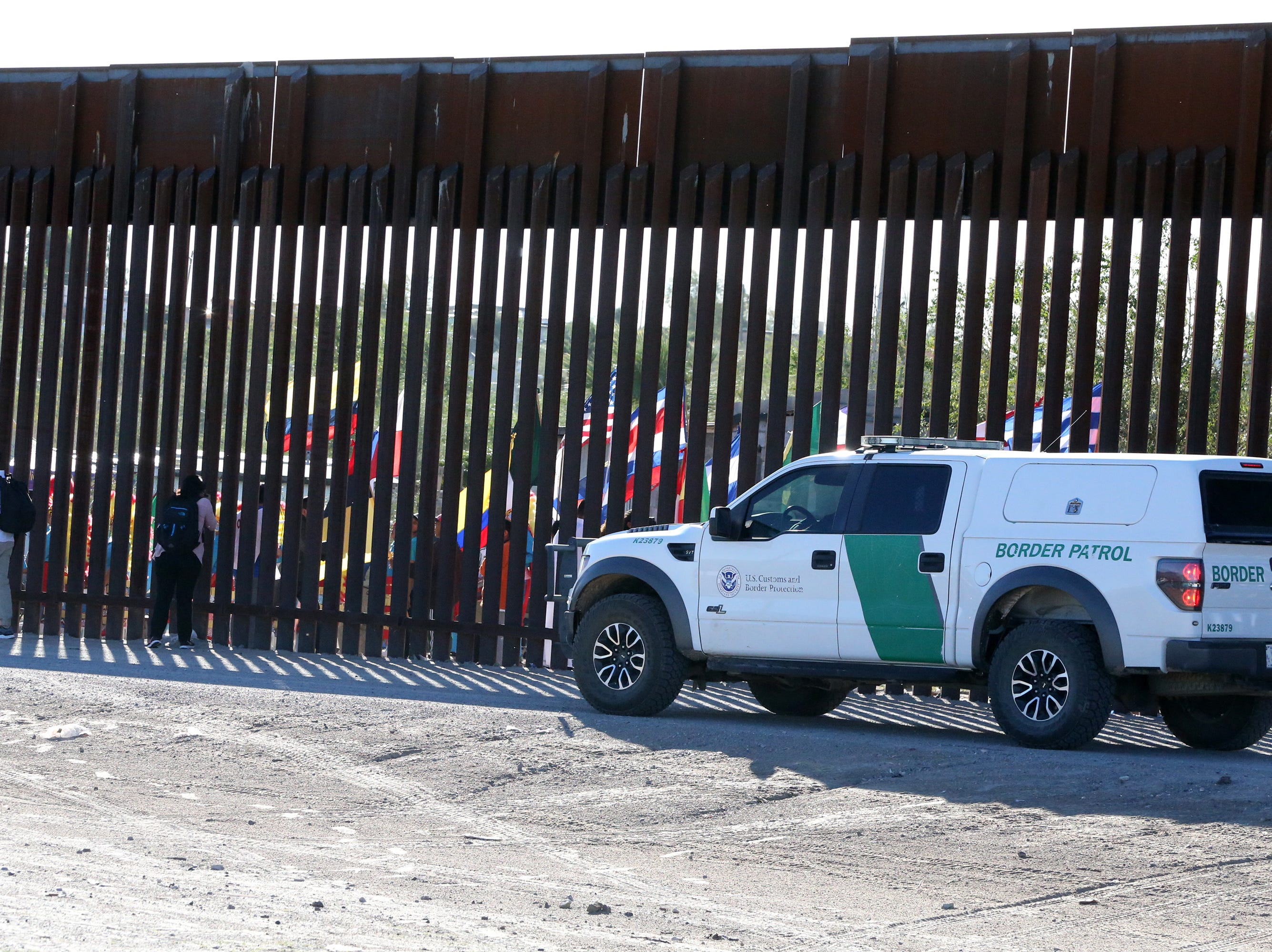 A U.S. Border Patrol vehicle at the border fence Saturday.