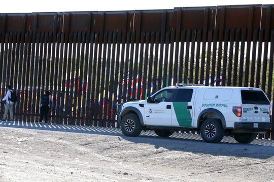 A U.S. Border Patrol vehicle at the border fence.