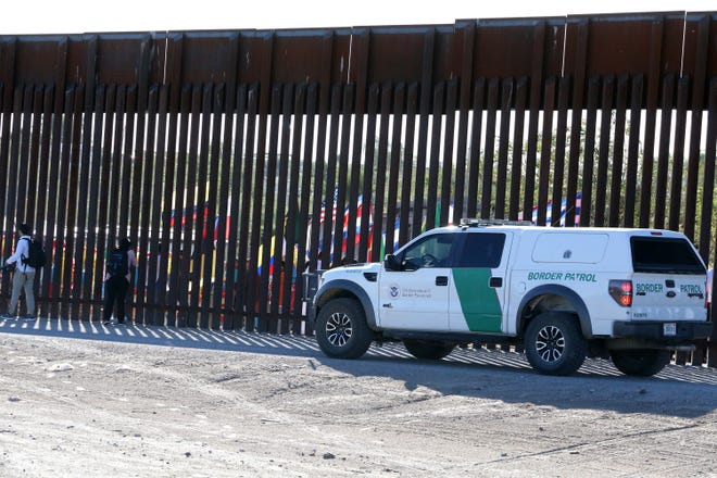 A U.S. Border Patrol vehicle at the border fence.