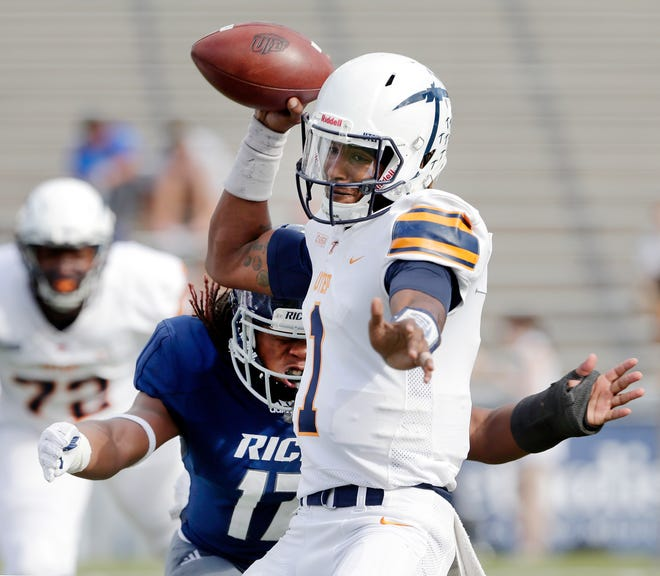 UTEP quarterback Kai Locksley (1) is sacked as he attempts to pass by Rice linebacker Treshawn Chamberlain (17) during the first half of an NCAA college football game Saturday, Nov. 3, 2018, in Houston.