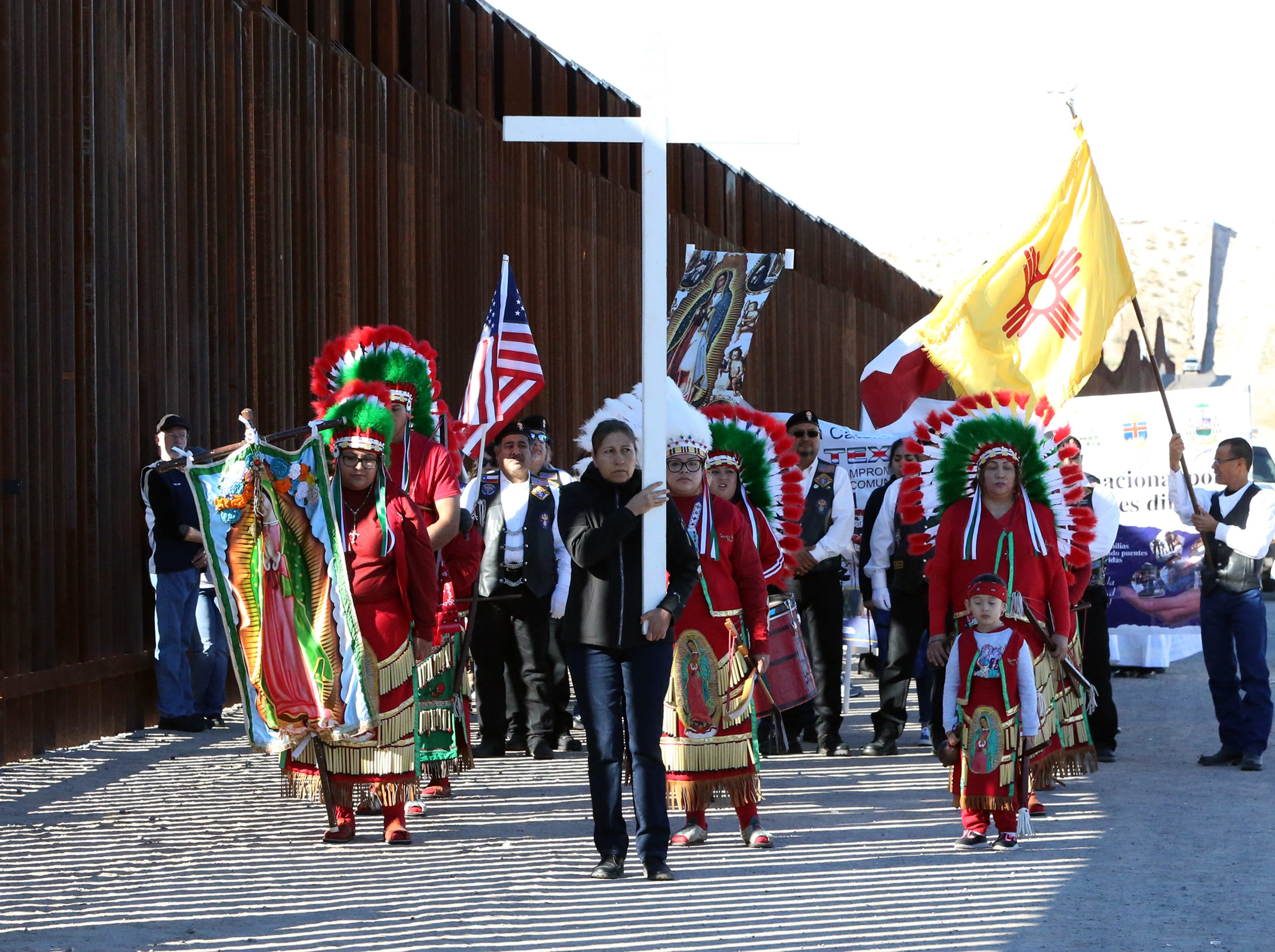 A short procession took place on both sides of the border fence during the the annual Border Mass in the Anapra area of Sunland Park, N.M.