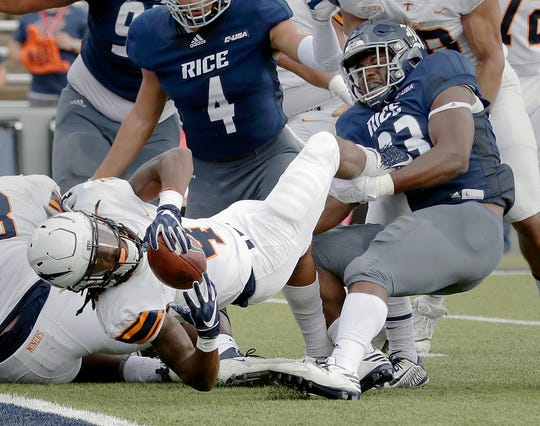 UTEP running back Quardraiz Wadley (4) is stopped a yard short of the goal line by Rice linebacker Anthony Ekpe (33) during the first half of an NCAA college football game Saturday, Nov. 3, 2018, in Houston.