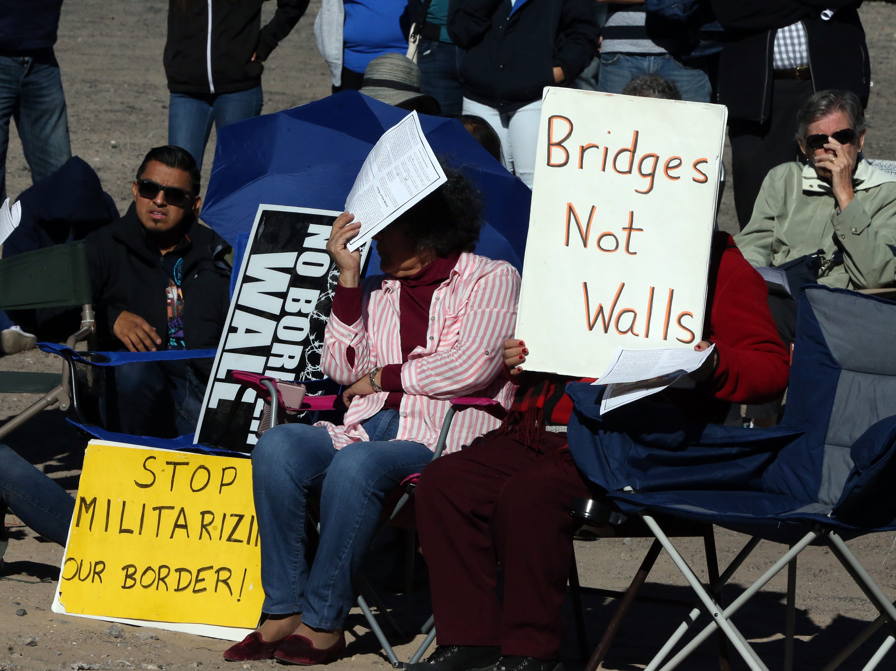 Signs on the U.S. side of the Border Mass Saturday.