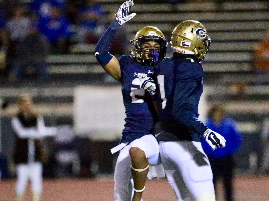Coronado's Jonathon Seabrook, left, celebrates a TD in The second quarter of play Friday night at Coronado. Extra point was good. 17-3 Coronado.