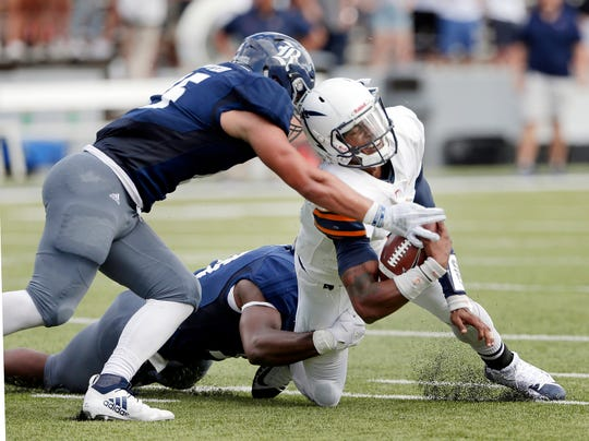 UTEP quarterback Kai Locksley, right, is sacked by Rice linebacker Antonio Montero, left, and Anthony Ekpe, bottom, during the first half of an NCAA college football game Saturday, Nov. 3, 2018, in Houston.