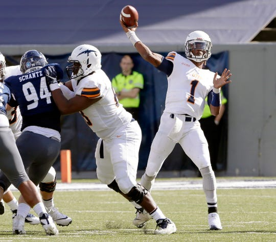 UTEP quarterback Kai Locksley (1) passes the ball as UTEP offensive lineman Zuri Henry (68) blocks Rice defensive end Graysen Schantz (94) during the first half of an NCAA college football game Saturday, Nov. 3, 2018, in Houston.