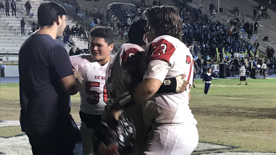 Offensive linemen Steven Sanchez (middle) and Chris Dal Pozzo (right) console each other after Rio Mesa's season ended with a loss to Camarillo in the first round of the CIF-Southern Section Division 4 playoffs on Friday night at Camarillo High.