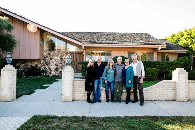"""In this Thursday photo provided by HGTV,  members of the """"The Brady Bunch"""" cast gather at the home that was featured in the opening and closing of the sitcom. HGTV purchased the home in the Studio City neighborhood in Los Angeles for its new series, """"A Very Brady Renovation."""""""