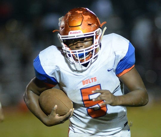 Millville's Tex Thompson carries the ball during Friday night's South Jersey Group 4 first round football game against Winslow at Millville Memorial High School, Nov. 2, 2018.