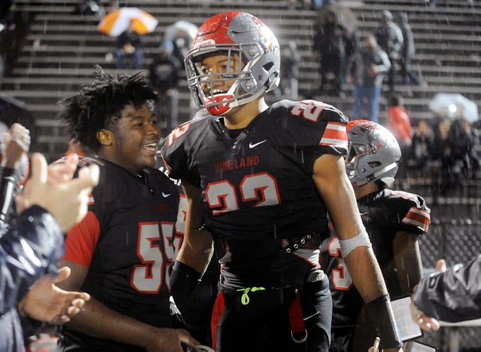 Vineland's Jhamir Malloy (55) and Tyreem Powell (22) celebrate after winning against Toms River North. The Fighting Clan blanked the Mariners, 33-0, on Friday, November 2, 2018.
