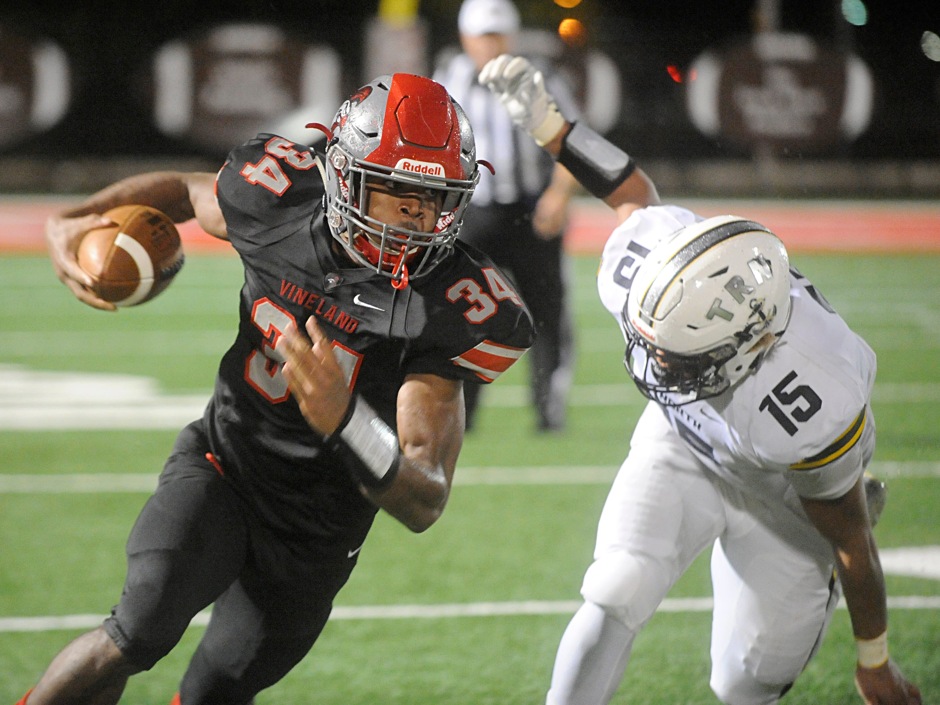 Vineland's Nahzir Broome runs for a gain against visiting Toms River North. The Fighting Clan blanked the Mariners, 33-0 on Friday, November 2, 2018.