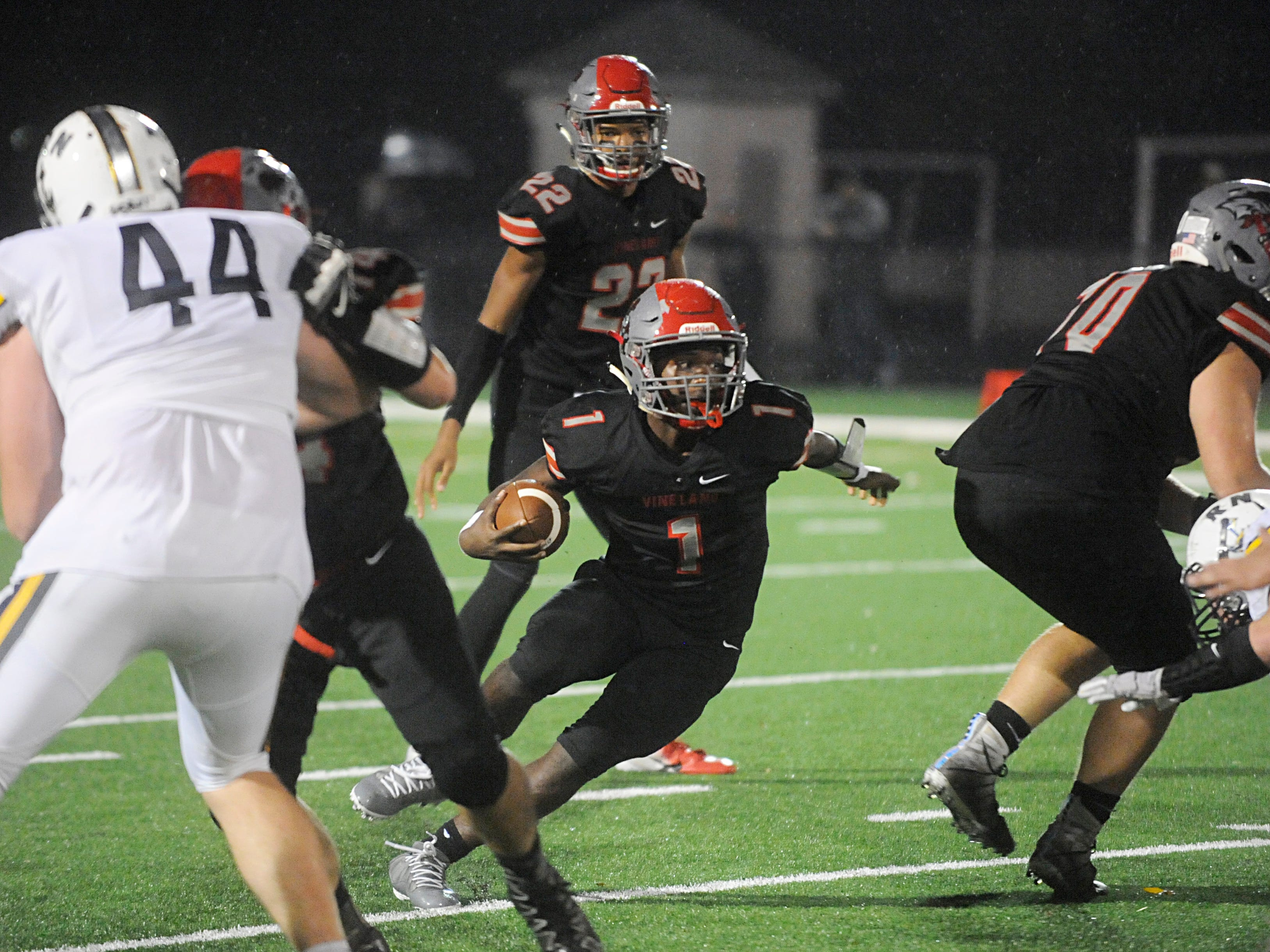 Vineland's Anthony Arthur runs for a gain against visiting Toms River North. The Fighting Clan blanked the Mariners, 33-0, on Friday, November 2, 2018.