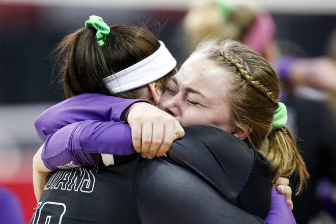 Mosinee's Lindsey Brown, left, embraces teammate Abbie Gonzalez after a loss to East Troy during the WIAA Girls State Volleyball Tournament at the Resch Center on Friday.