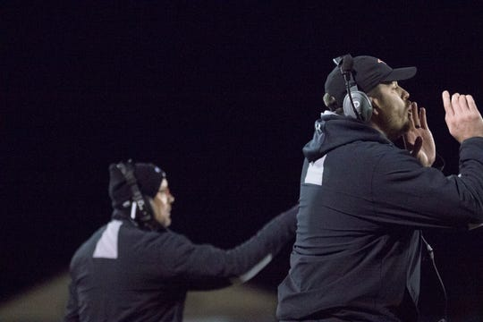 Iola-Scandinavia coaches shout out instructions during the Thunderbirds' 41-28 win over Abbotsford in the Division 6 state quarterfinals last Friday.