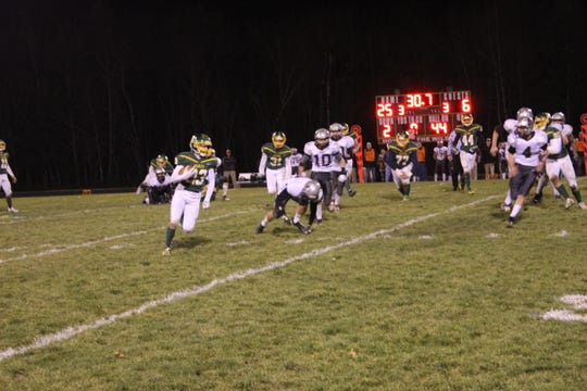 Edgar running back Kyle Brewster races upfield near the end of Edgar's 25-6 WIAA Division 7 Level 3 playoff game against Loyal in Edgar on Friday night.
