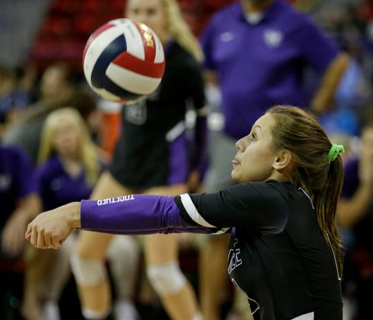 Mosinee's Zoe Gburek bumps the ball against East Troy during Friday's state semifinal match Friday.