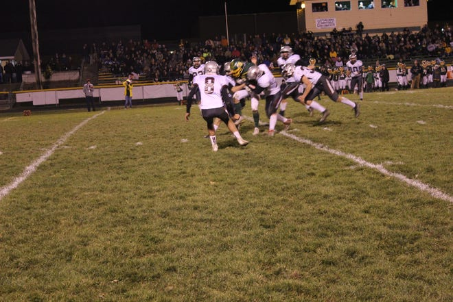 Loyal defenders attempt to bring down an Edgar receiver on Friday in a WIAA Division 7 Level 3 game.