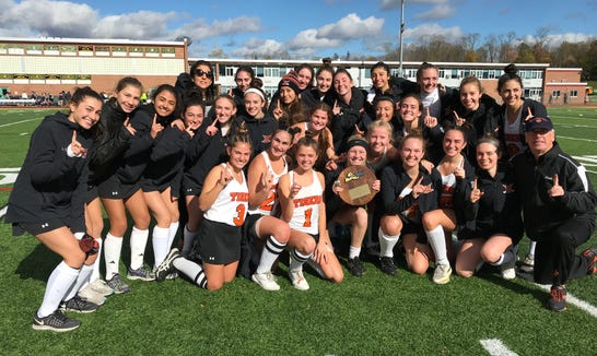 Mamaroneck's field hockey team pose with the championship plaque after beating Saratoga during their regional field hockey game at Lakeland High School, Nov. 3, 2018.