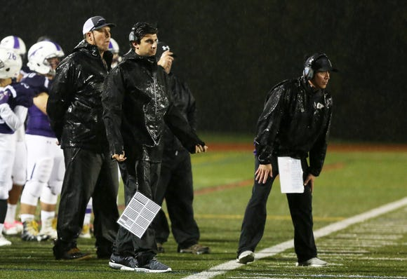 John Jay-Cross River coach Jimmy Clark gives instructions to his team during the Section 1 Class A championship at Mahopac High School Nov. 2, 2018. John Jay defeated Rye 21-14.