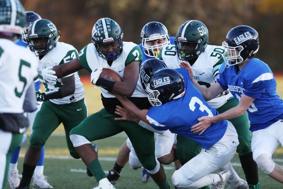 Woodlands' Omari Kendrick (7) looks for some running room in the Dobbs Ferry defense during the Section 1 Class D championship game at Mahopac High School Nov. 3,  2018.