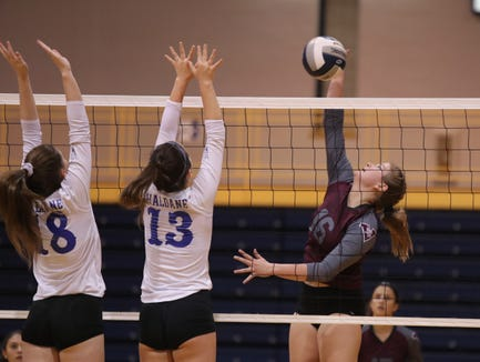 Valhalla's Linda Rossi (16) spikes a shot as Haldane's Maria Barry (18) and Melissa Rodino (13) attempt a block during their 3-1 win over Haldane in the girls class C volleyball section finals at Pace University in Pleasantville on Saturday, November 3, 2018.